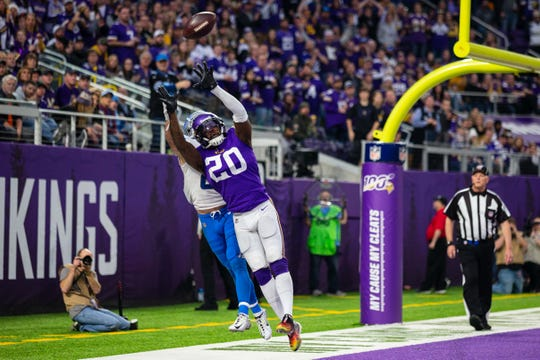Minnesota Vikings cornerback Mackensie Alexander (20) breaks up a pass intended for Detroit Lions wide receiver Danny Amendola (80) during the fourth quarter at U.S. Bank Stadium.