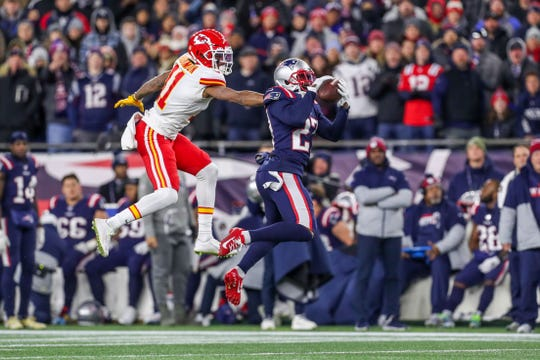 New England Patriots cornerback J.C. Jackson (27) intercepts a pass by Kansas City Chiefs quarterback Patrick Mahomes (not pictured) during the first half at Gillette Stadium.
