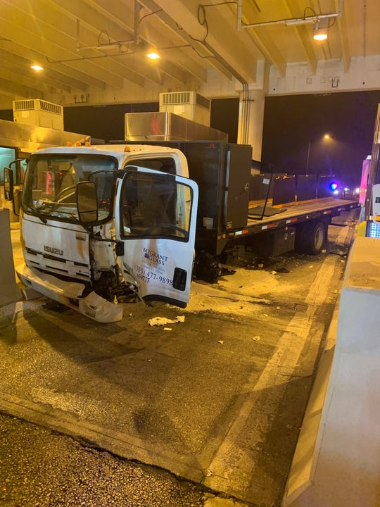 This single-vehicle crash closed multiple lanes of the Collier County toll plaza on Friday, Jan. 3, 2020.