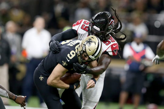 New Orleans Saints quarterback Drew Brees (9) is sacked by Atlanta Falcons outside linebacker De'Vondre Campbell (59) in the first quarter at the Mercedes-Benz Superdome.