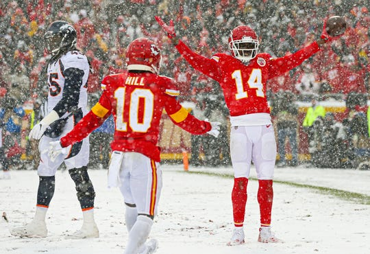 Kansas City Chiefs wide receiver Sammy Watkins (14) celebrates with wide receiver Tyreek Hill (10) after converting a two-point conversion against Denver Broncos linebacker A.J. JohnsonÊ(45) during the second half at Arrowhead Stadium.