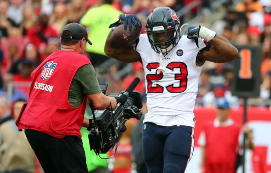 Houston Texans running back Carlos Hyde (23) celebrates as he scores a touchdown against the Tampa Bay Buccaneers during the first half at Raymond James Stadium.