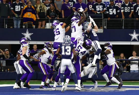 Minnesota Vikings safety Jayron Kearse (27) intercepts the ball on the last play of the game against the Dallas Cowboys at AT&T Stadium.