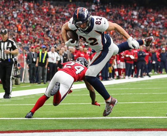 Denver Broncos tight end Jeff Heuerman (82) scores a touchdown past Houston Texans cornerback Johnathan Joseph (24) during the second quarter at NRG Stadium.