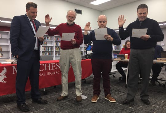 Schools Business Administrator John Serapiglia administers oaths of office to returning trustees Jeffrey Fischer and Valdo Panzera, and newcomer Emilio Barca.