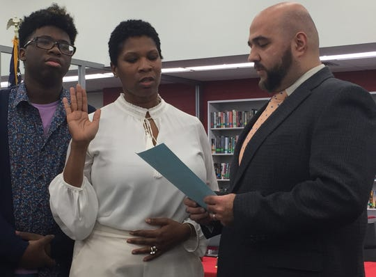 Bridget Arrick, accompanied by her son, Stacy Jr., is sworn in to her term on the Manchester Regional Board of Education by Prospect Park Mayor Mohamed Khairullah at the high school in Haledon on Jan. 2.