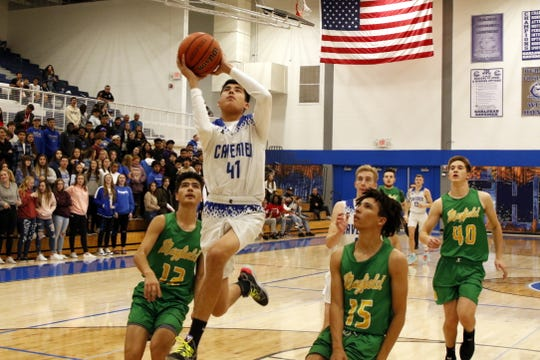 Carlsbad's Damien Perez goes for a fastbreak layup against Mayfield on Jan. 2, 2020. Carlsbad won, 68-56.