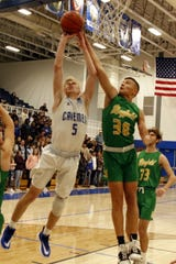 Carlsbad's Evan Sullivan goes for a contested shot against Mayfield's Micah Deshaun Ortiz on Jan. 2, 2020. Carlsbad won, 68-56.