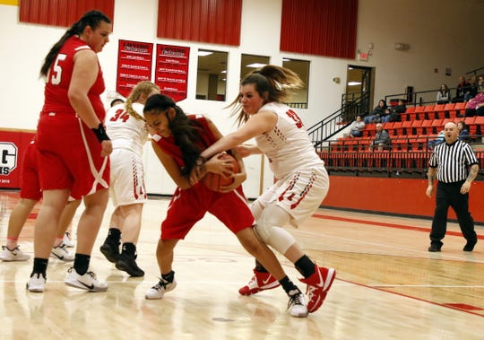 Loving's Faith McDonald, right, fights for a loose ball against the Roswell JV on Jan. 2, 2020.