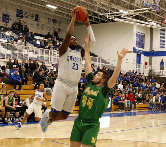 Carlsbad's Shamar Smith goes for a fastbreak layup against Mayfield's Miles Maribal on Jan. 2, 2020. Smith led all scorers with 19 points and Carlsbad won, 68-56.