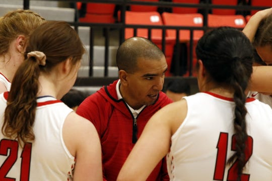 Loving head coach Derrick Martinez talks to his team during a timeout against the Roswell JV on Jan. 2, 2020. Roswell won, 35-34.
