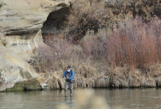 An angler fishes, Friday, Jan. 3, 2020, at Texas Hole, a popular fishing spot on the San Juan River.