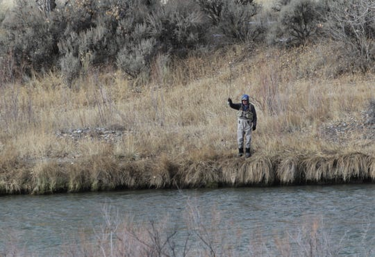 An angler fishes from shore, Friday, Jan. 3, 2020, near the Simon Canyon parking lot near the Community of Navajo Dam.