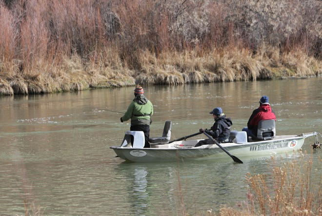 Anglers fish from a boat, Friday, Jan. 3, 2020, at Texas Hole on the San Juan River in Navajo Lake State Park.