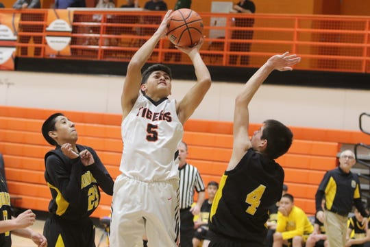 """Aztec's Alex Parra puts up a shot against Coronado during Thursday's """"Rumble in the Jungle"""" tournament opener at Lillywhite Gym in Aztec."""
