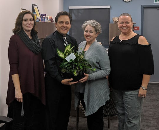 Julio Omier with, from left, Rancho Mirage High Principal Teresa Haga, Superintendent of Schools Sandra Lyon and PSTA President Karen Johnson.
