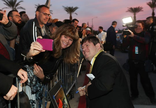 Zack Gottsagen takes photos with fans at the Palm Springs International Film Festival Awards Gala at the Palm Springs Convention Center, January 2, 2020.