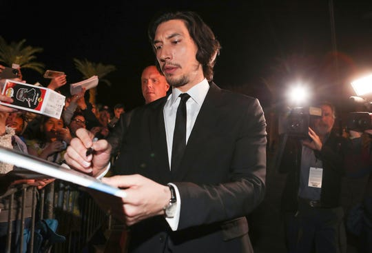 Adam Driver signs autographs for fans at the Palm Springs International Film Festival Awards Gala at the Palm Springs Convention Center, January 2, 2020.
