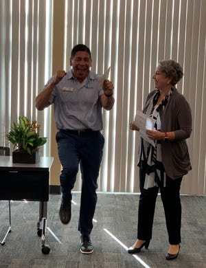 A surprised Bernie Marez gets the good news from Superintendent of Schools Sandra Lyon.