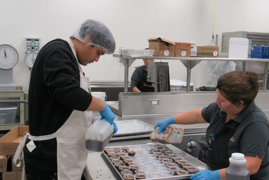 More CAFÉ students prep meals at the Nutritional Services Department.