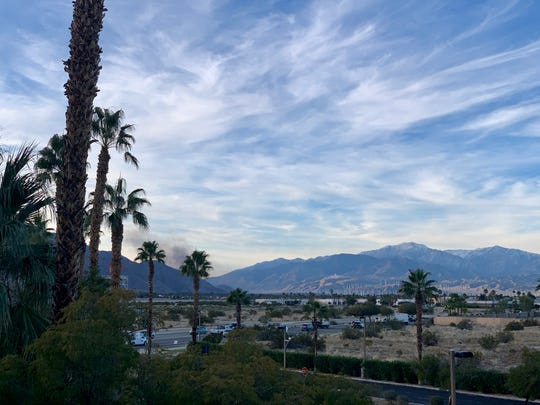 Smoke from a possible mobile home fire can be seen from the Desert Sun's offices on Thursday, Jan. 2.