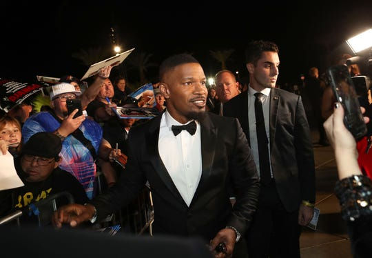 Jamie Foxx signs autographs for fans at the Palm Springs International Film Festival Awards Gala at the Palm Springs Convention Center, January 2, 2020.