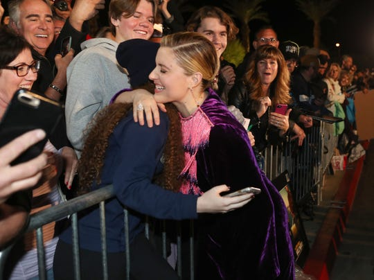 Greta Gerwig has a moment with fan Malia Reed while signing autographs for fans at the Palm Springs International Film Festival Awards Gala at the Palm Springs Convention Center, January 2, 2020.