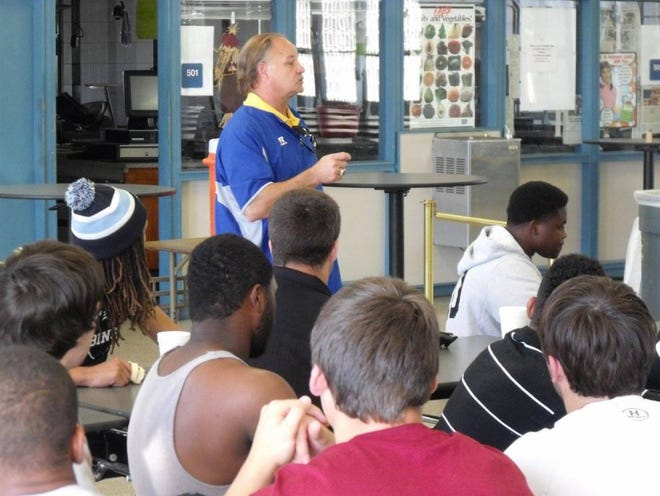 Former high school, college football coach Dave Wilson speaks to young athletes during a previous recruiting seminar. Wilson will host a free event on Tuesday at the Studer Community Institute building.