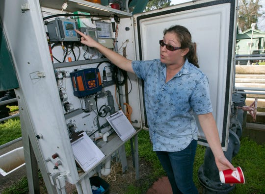 Jena Roberge, utility manager for the city of Gulf Breeze, monitors the production of reclaimed water at the Tiger Point Wastewater Treatment facility in Gulf Breeze on Friday.