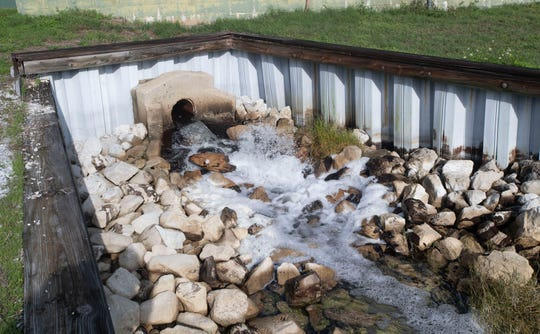 The Tiger Point Wastewater Treatment facility in Gulf Breeze discharges clean reclaimed water into a holding pond Friday.