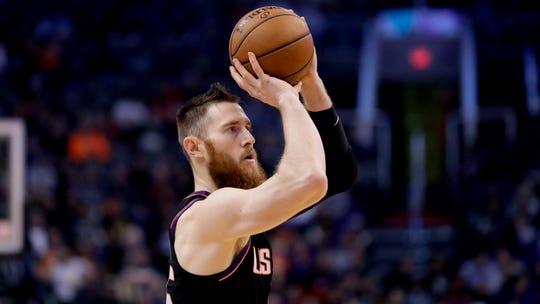 Phoenix Suns center Aron Baynes against the Minnesota Timberwolves during the second half of an NBA basketball game, Monday, Dec. 9, 2019, in Phoenix. (AP Photo/Matt York)