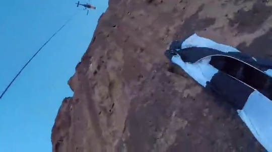The Arizona Department of Public Safety released video of a rescue involving a base jumper who got stuck on the side of the Superstition Mountains.
