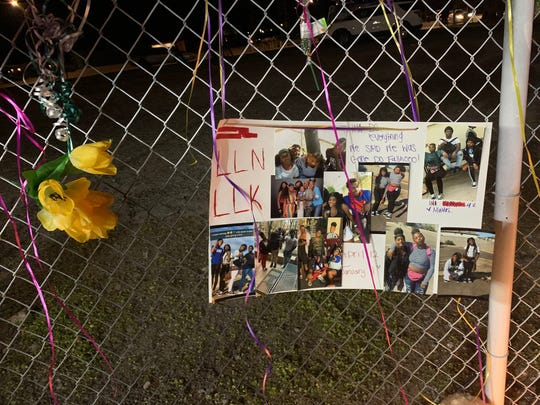 A poster at a vigil for Kaniesha Sutton, 16, who died after a crash New Year's Day in Phoenix.
