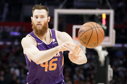 Phoenix Suns center Aron Baynes plays against the Los Angeles Clippers during the second half of an NBA basketball game in Los Angeles, Tuesday, Dec. 17, 2019. (AP Photo/Chris Carlson)