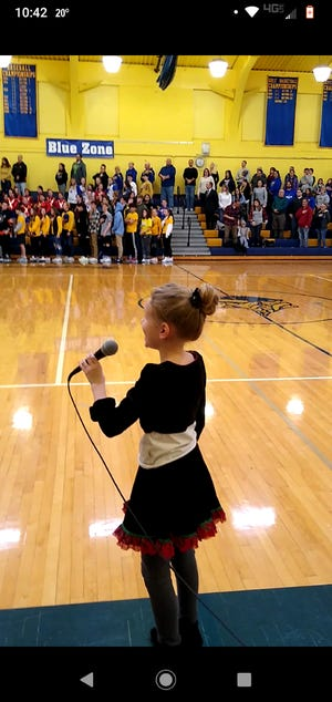 All eyes are on 10-year old Grace Signor when she sings the national anthem before Northern Lebanon basketball games