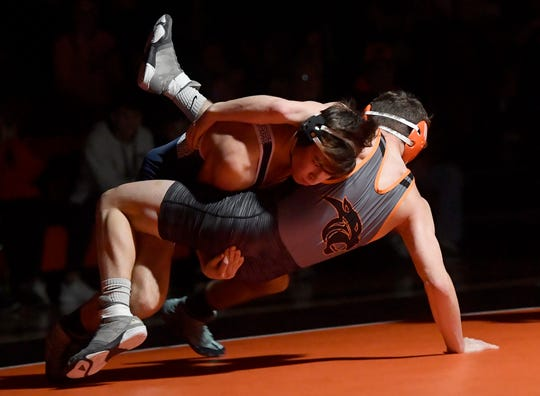 Dallastown's Carson Hedghn takes Gavin Heist of Central York to the mat during the 152 pound match, Thursday, January 2, 2020.John A. Pavoncello photo