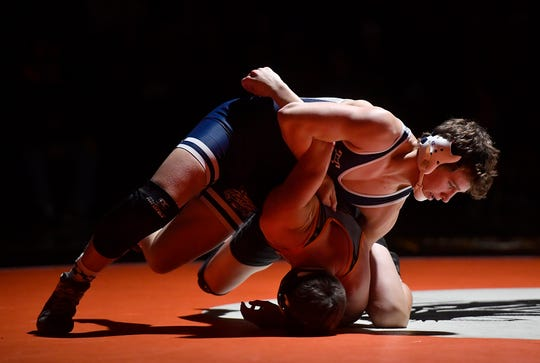 Brooks Gable, seen here at top in a file photo, helped the Dallastown Wildcats advance to the District 3 Class 3-A wrestling semifinals with two wins on Tuesday.