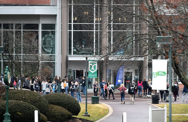 Students walk on the York College campus Friday, Jan. 3, 2020.