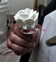 Brown's Orchards & Farm Market cake decorator Jen Rutters uses a piping bag to decorate a Valentine basket weave cake in the market's bakery Friday, Jan. 3, 2020. Construction is underway an event venue at the farm market. A spokesperson said event organizers have the option of using the market's bakery and catering services during events. Bill Kalina photo