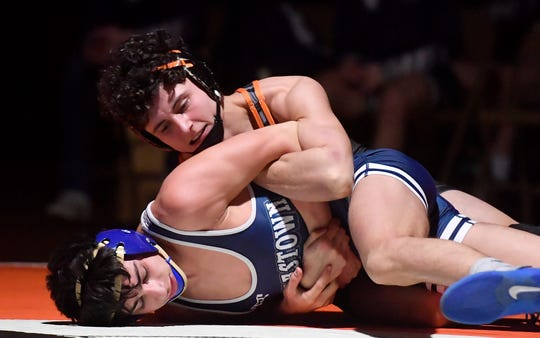Central York's Mason Myers, seen here at top in a file photo, finished his high school wrestling career with 124 wins.