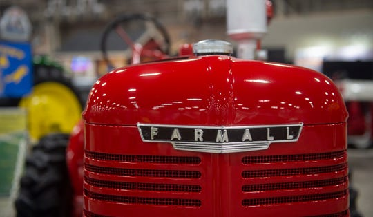 An antique Farmall tractors sits on display floor at the 2020 PA Farm Show on Friday, Jan. 3. The annual 10-day convention draws in thousands of attendees and helps contribute to a billion-dollar tourism industry for the state.