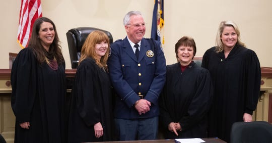 Newly re-elected Sheriff Richard P. Keuerleber, center, poses with local judges after taking the oath of office on  Friday morning at the York County Administrative Center. A number of county officials were sworn-in during the ceremony. From left, are Judge Andrea Marceca Strong, Judge Kathleen J. Prendergast, Sheriff Richard P. Keuerleber, Judge Maria Musti Cook and Judge Amber A. Kraft. These four women are incumbent judges.