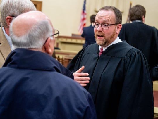 In this photo from Jan. 3, York County Common Pleas Judge Matthew D. Menges speaks with friends after being sworn-in to his position on the bench.