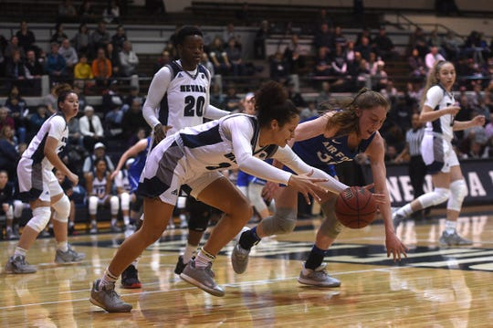 Nevada's Essence Booker (3) fights for a loose ball while taking on Air Force during their basketball game at the Old Virginia Street Gym in Reno on Dec. 7, 2019.