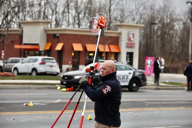 Greece police investigate the death of a pedestrian who was struck by two vehicles on Long Pond Road on Jan. 3, 2020.