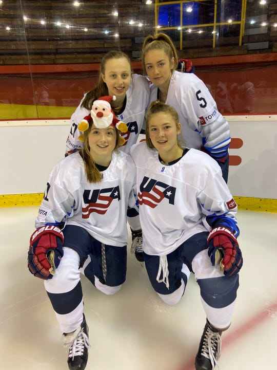 Team USA members, front row, Kiara Zanon of Fairport and Haley Winn of  Webster and back, Kirsten Simms and Caroline Harvey pose after winning the 2020 IIHF Women's World Championship in Bratislava, Slovakia. Winn, Simms and Harvey attend the Selects Academy at Bishop Kearney.