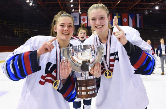 Webster's Haley Winn, left,  celebrates with Maggie Nicholson after the United States defeated Canada in the gold medal game at the 2020 IIHF Ice Hockey U18 Women's World Championship in Bratislava, Slovakia.