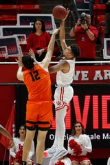 Utah forward Timmy Allen, right, shoots as Oregon State center Roman Silva (12) defends in the first half during an NCAA college basketball game Thursday, Jan. 2, 2020, in Salt Lake City.