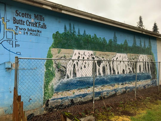 A mural of the Scotts Mills Dam is painted on the wall of a local antique store in Scotts Mills. The dam has been neglected for decades as no one was sure who owned it, but a proposal could have it torn down within the year.