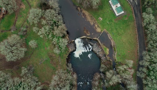 The Scotts Mills Dam, seen from above, has been neglected for decades as no one was sure who owned it, but a proposal could have it torn down within the year.